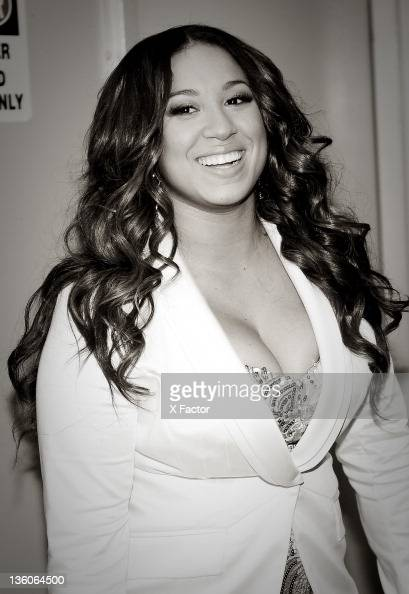 Contestant Melanie Amaro poses backstage at FOX's 'The X Factor' Top 3 Live Performance Show on December 21 2011 in Hollywood California THE X FACTOR...