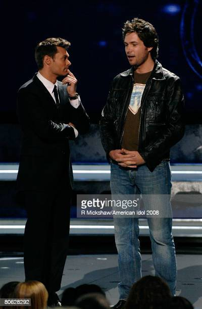 ACCESS*** Contestant Michael Johns with Host Ryan Seacrest after being eliminated from the competition during live show of American Idol April 10...