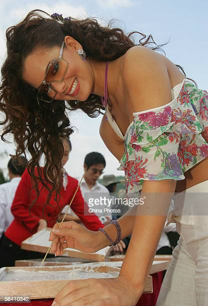 Contestant of the 55th Miss World 2005 Ingrid Marie Rivera Santos of Puerto Rico prints her hand mould during a tree planting event at the Beauty...