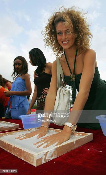 Contestant of the 55th Miss World 2005 Sofia Bruscoli of Italy prints her hand mould during a tree planting event at the Beauty Crown Centre on...