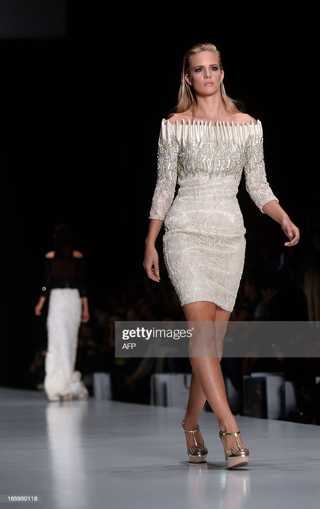 A contestant of the Miss Universe 2013 beauty pageant displays a creation by Lebanese designer Tony Ward during the Russian Fashion Week in Moscow, on October 26, 2013. The Fashion Week takes place from October 25 to October 31.