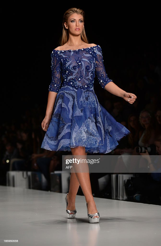 Contestant of the Miss Universe 2013 beauty pageant, Miss Great Britain 2013 Amy Willerton displays a creation by Lebanese designer Tony Ward during the Russian Fashion Week in Moscow, on October 26, 2013. The Fashion Week takes place from October 25 to October 31.