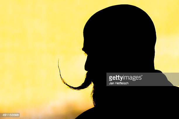 A contestant of the World Beard And Mustache Championships poses for a picture during a break of the Championships 2015 on October 3 2015 in Leogang...