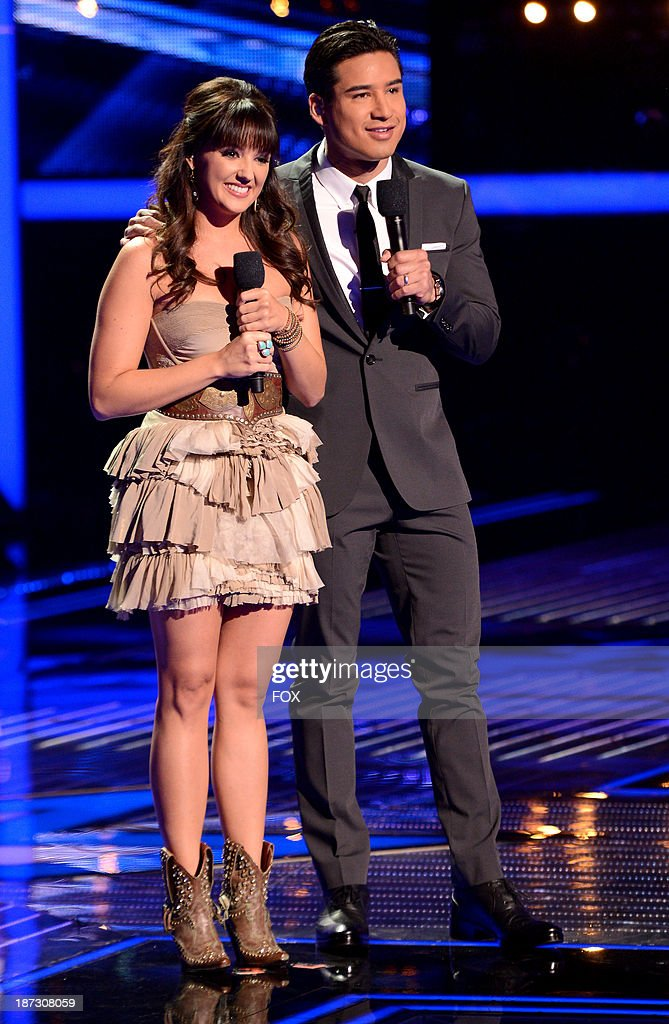 Contestant Rachel Potter (L) and host Mario Lopez onstage on FOX's 'The X Factor' Season 3 Top 13 Perform Again Live on November 7, 2013 in Hollywood, California.
