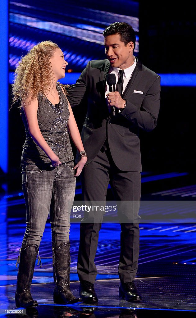 Contestant Rion Paige (L) and host Mario Lopez onstage on FOX's 'The X Factor' Season 3 Top 13 Perform Again Live on November 7, 2013 in Hollywood, California.