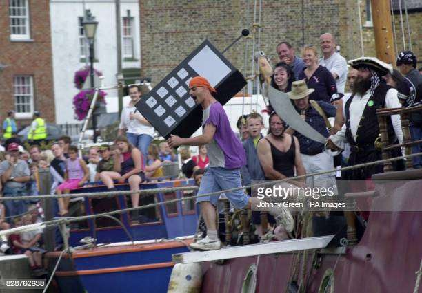 A contestant takes part in the 7th World Walking the Plank Championships in Queenborough on the Isle of Sheppey in Kent A Queenborough local Heini...