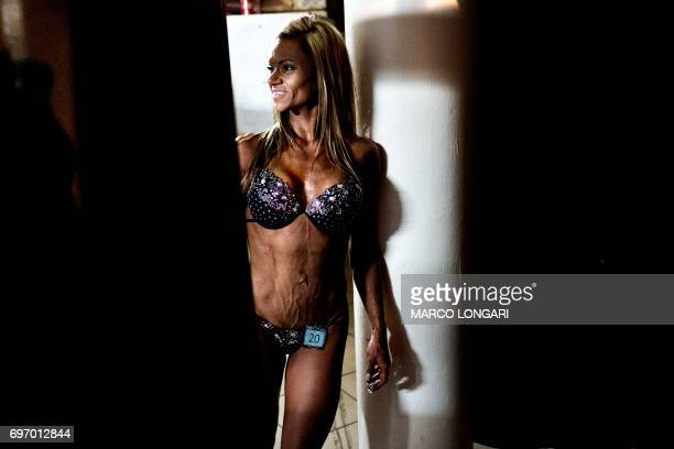 A contestant waits to compete at the Miss SA Xtreme fitness and bodybuilding show in Pretoria on June 17 2017 Dozens of local bodybuilding and...