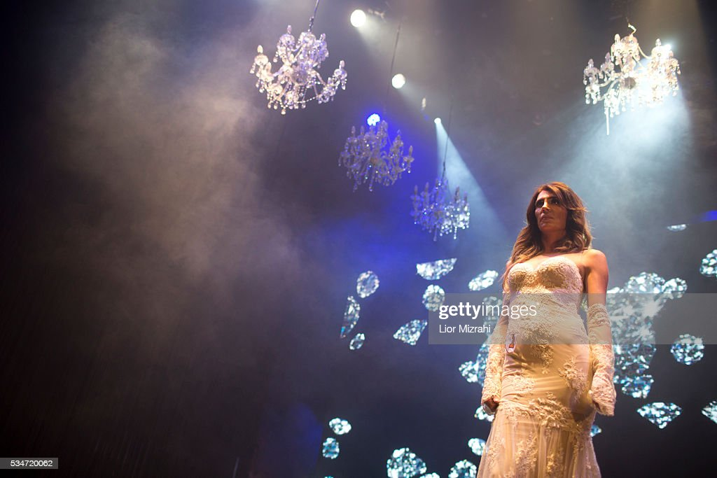A contestant walks on stage during the first Miss Trans Israel beauty pageant on May 27, 2016 in Tel Aviv, Israel. Twelve Israeli transgender finalists took part in the event. The event marks the beginning of the 2016 Pride events.