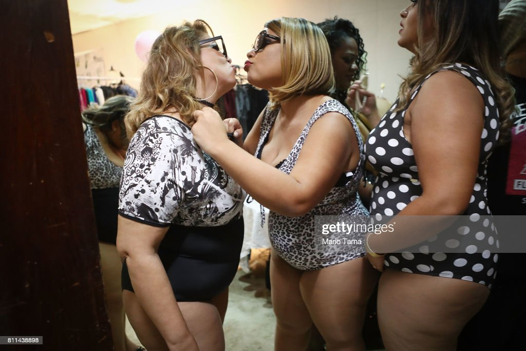Contestants air kiss whike preparing to compete during the Miss Plus Size Carioca beauty pageant on July 8, 2017 in Rio de Janeiro, Brazil. 24 contestants, aged 18-45, competed in the contest which aims to challenge modern inclusive standards of beauty.