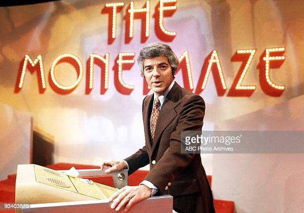 MONEYMAZE 197475 Contestants answered questions and then from their positions overlooking a giant maze guided their partners through the maze toward...