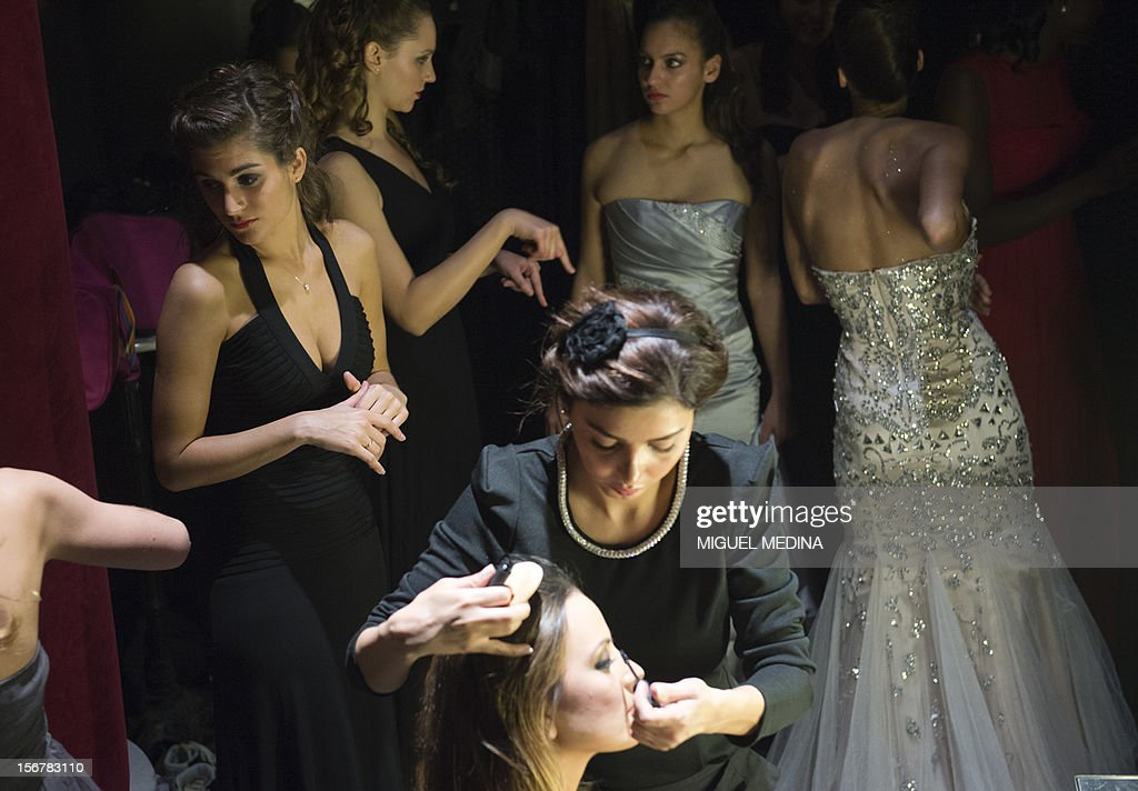 Contestants are pictured backstage on November 20, 2012 in the southern Paris suburb of Rungis during the 2012 Miss Ile-de-France (Greater Paris area) beauty contest. AFP PHOTO / MIGUEL MEDINA