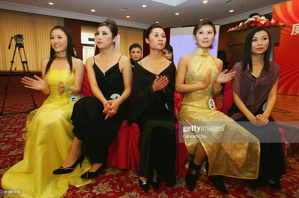 Contestants attend a news conference promoting the first Miss Plastic Surgery on December 12, 2004 in Beijing, China. 19 contestants ranging from 17 to 62 year-old from around China will take part in the contest, which officially named 'Artificial Beauty' Pageants on Dec 18.