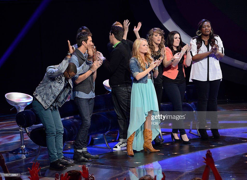 Contestants Burnell Taylor, Paul Jolley, Amber Holcomb, Lazaro Arbos, Devin Velez, Janelle Arthur, Angie Miller, Kree Harrison and Candice Glover onstage at FOX's 'American Idol' Season 12 Top 10 To 9 Live Elimination Show on March 14, 2013 in Hollywood, California.