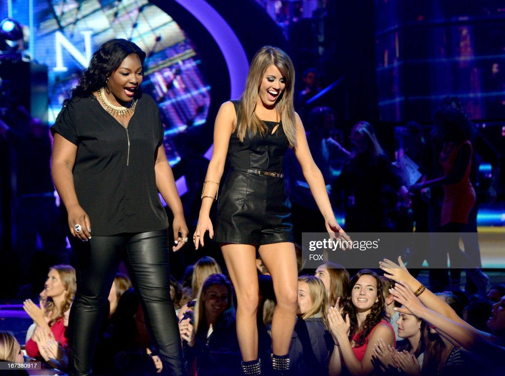 Contestants Candice Glover and Angie Miller perform onstage at FOX's 'American Idol' Season 12 Top 4 Live Performance Show on April 24 2013 in...