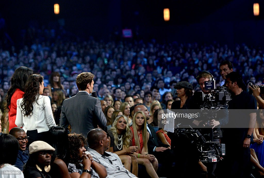 Contestants Candice Glover (L), Kree Harrison and host Ryan Seacrest (R) in the audience at FOX's 'American Idol' Season 12 Top 2 Live Performance Show at Nokia Theatre L.A. Live on May 15, 2013 in Los Angeles, California.