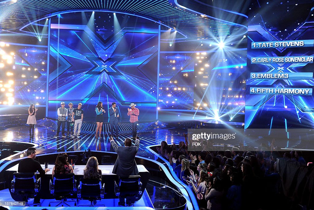 Contestants Carly Rose Sonenclar, Emblem3, hosts Khloe Kardashian and Mario Lopez and contestant Tate Stevens onstage at FOX's 'The X Factor' Season 2 Top 6 to 4 Live Elimination Show on December 6, 2012 in Hollywood, California.