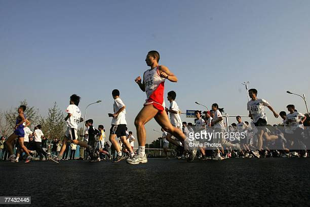 Contestants compete in the 2007 Beijing International Marathon on October 21 2007 in Beijing China Nephat Kinyanjui of Kenya won the men's event...