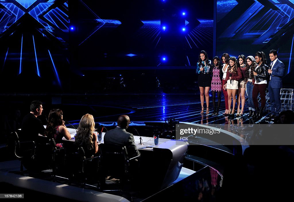 Contestants Diamond White (second L) and Fifth Harmony (3rd Left)and hosts Khloe Kardashian (L) and Mario Lopez onstage at FOX's 'The X Factor' Season 2 Top 6 to 4 Live Elimination Show on December 6, 2012 in Hollywood, California.