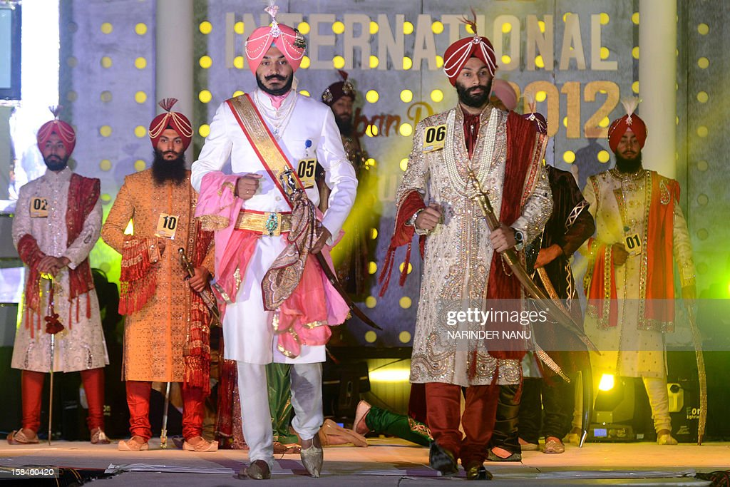 Contestants display traditional Sikh wedding groom attire during the Mr. Singh International Turban Pride 2012 Fashion Show in Amritsar late December 16,2012. A total of 26 contestants participated in the event in the northern Indian city.