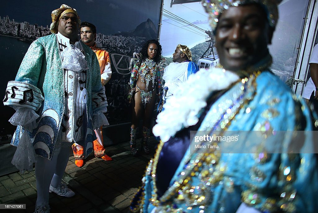 Contestants for king and queen look on during a break at the ceremony deciding Rio's 2014 Carnival Queen and King in the port district on November 8, 2013 in Rio de Janeiro, Brazil. Rio's Carnival runs February 28 through March 4, just three months before the start of the 2014 FIFA World Cup in June.