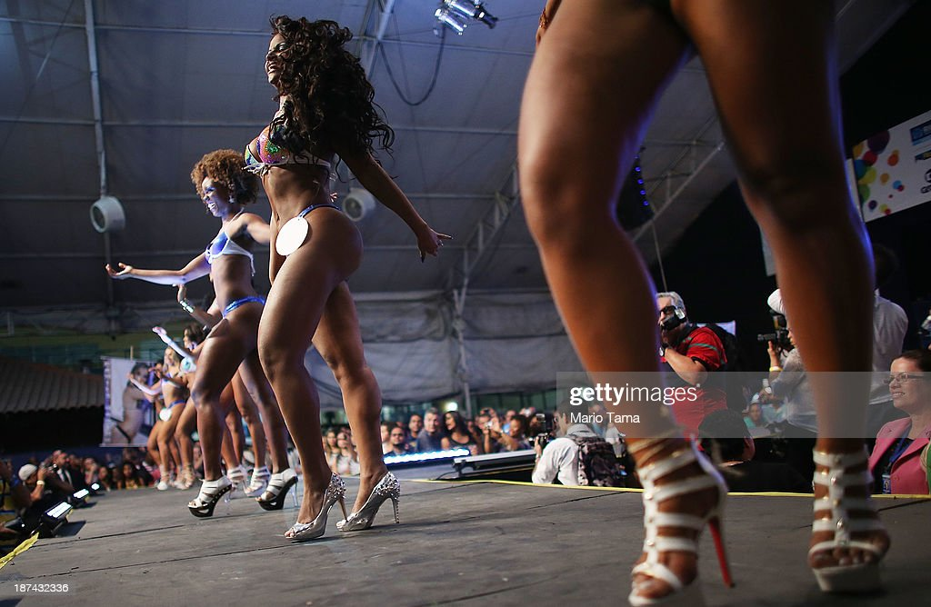 Contestants for Queen perform at the ceremony deciding Rio's 2014 Carnival Queen and King in the port district on November 8, 2013 in Rio de Janeiro, Brazil. Rio's Carnival runs February 28 through March 4, just three months before the start of the 2014 FIFA World Cup in June.