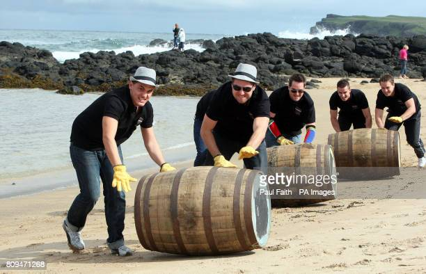 Contestants from Germany South Africa and the Czech Republic compete in barrel rolling on the north Antrim coast