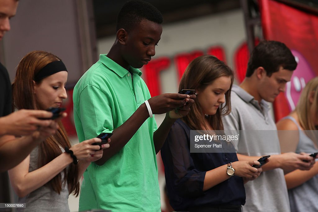 Contestants in the Sixth Annual LG Mobile U.S. National Texting Championships compete on stage on August 8, 2012 in New York City. This years winner was again Austin Wierschke who took home $50,000.