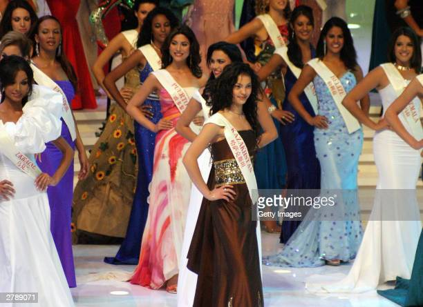 Contestants in this year's Miss World beauty contest are seen on stage December 6 2003 at the Miss World contest in Hainan China The live show was...
