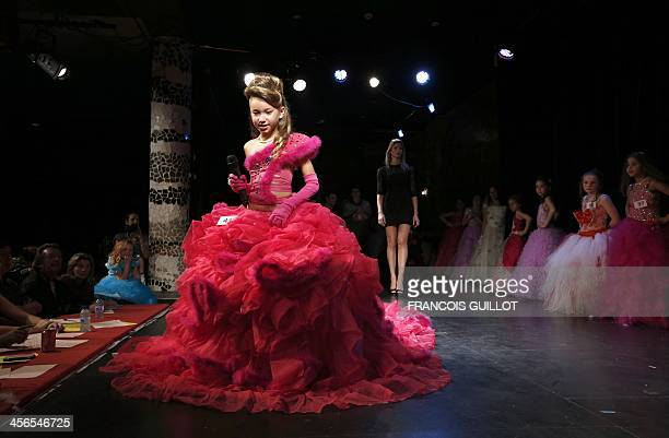 Contestants of the beauty contest mini Miss France 2014 for children from 5 to 11 years old parade on December 14 2013 in Paris AFP PHOTO/FRANCOIS...