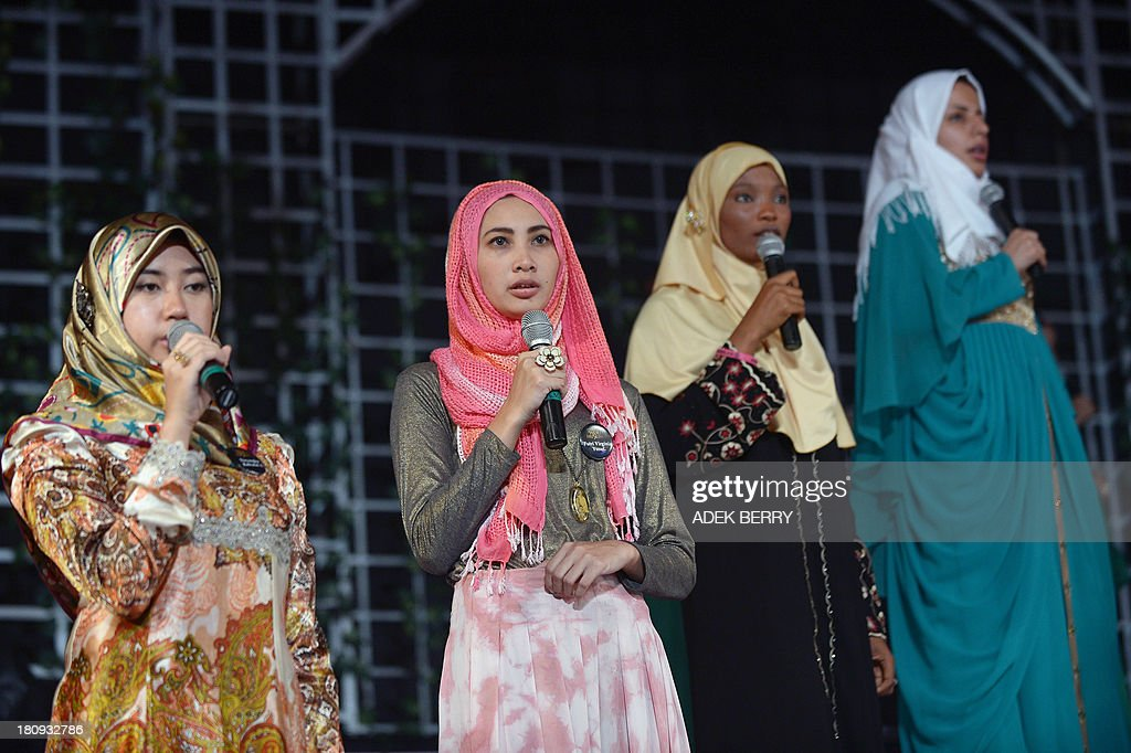Contestants of the Muslimah World pageant, Dayangku Rabiatul Adawiyah (L) of Brunei, Futri Virginia (2nd L) of Indonesia, Aisha Aderonkie Adeshina (2nd R) of Nigeria and Masoumeh Ebrahimi (R) of Iran take part in a rehearsal for the grand final of the contestin Jakarta on September 18, 2013. The finale of a beauty pageant exclusively for Muslim women will take place in the Indonesian capital on September 18, in a riposte to the Miss World contest in Bali that has drawn fierce opposition from Islamic radicals.