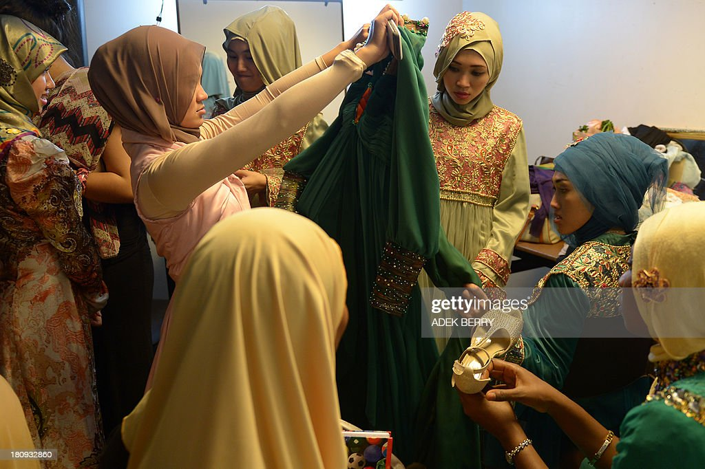 Contestants of the Muslimah World pageant prepare backstage for the grand final of the contest in Jakarta on September 18, 2013. The finale of a beauty pageant exclusively for Muslim women will take place in the Indonesian capital on September 18, in a riposte to the Miss World contest in Bali that has drawn fierce opposition from Islamic radicals.