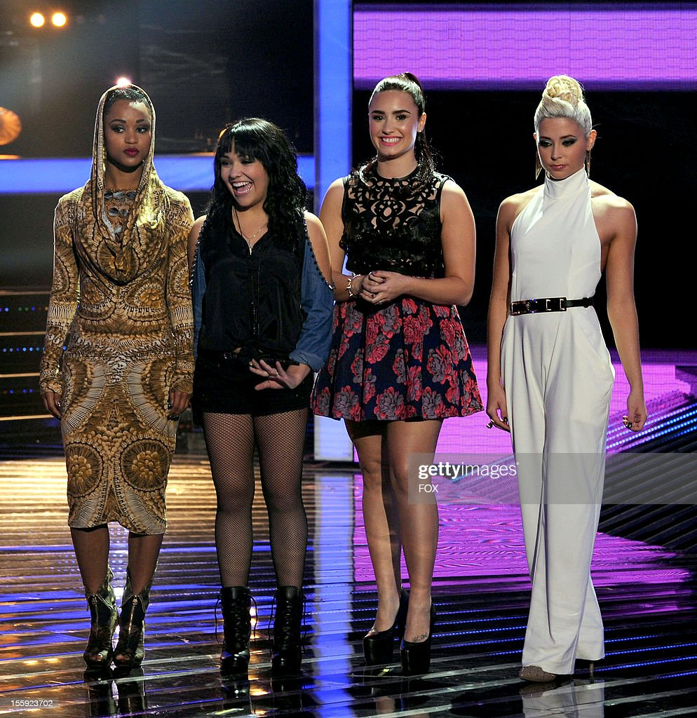 Contestants Paige Thomas Jennel Garcia judge Demi Lovato and contestant Cece Frey onstage at FOX's 'The X Factor' Season 2 Top 13 To 12 Live...