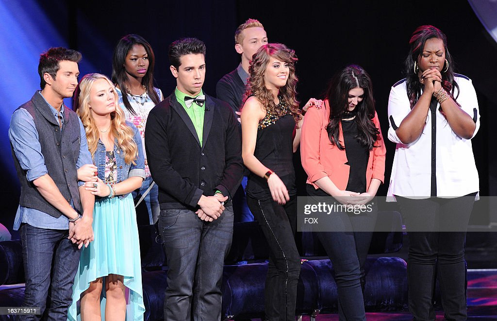 Contestants Paul Jolley, Janelle Arthur, Amber Holcomb, Lazaro Arbos, Devin Velez, Angie Miller, Kree Harrison and Candice Glover onstage at FOX's 'American Idol' Season 12 Top 10 To 9 Live Elimination Show on March 14, 2013 in Hollywood, California.