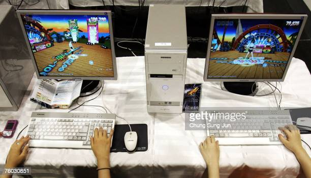 Contestants play computer games during the 'EStars Seoul 2007' game festival hosted by the Seoul Metropolitan Government at Seoul Olympic Park on...