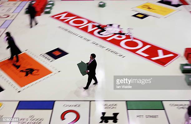 Contestants play on what is claimed to be the World's largest Monopoly board on the opening day of the Sydney Home Show May 12 2005 in Sydney...