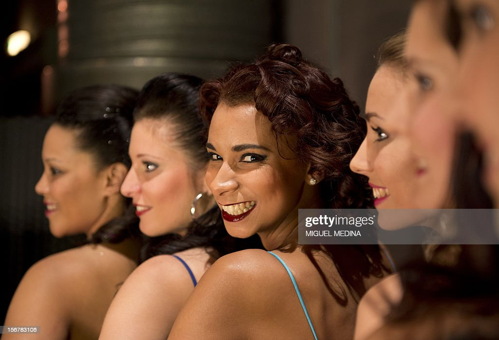 Contestants pose backstage on November 20, 2012 in the southern Paris suburb of Rungis during the 2012 Miss Ile-de-France (Greater Paris area) beauty contest.