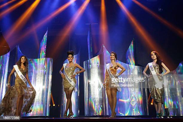 Contestants pose during ithe Miss International Queen Beauty Pageant on November 1 2013 in Pattaya Thailand Twentyfive transgender contestants from...