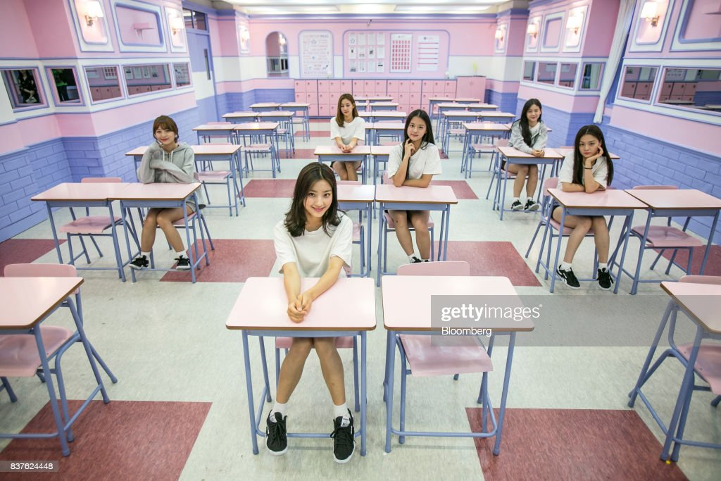 Contestants pose for a photograph during the production of the 'Idol School' reality television show by CJ E&M Corp.at the Yangpyeong English School in Yangpyeong, South Korea, on Thursday, June 29, 2017. Endless repetition, tear-inducing critiques from coaches, smile practice, and psychological counselling are plot points in an 11-week reality TV show documenting the creation of a teeny-bopper singing group. Idol School, which began airing in July, is part of a corporate push to turn Korean pop music into a global phenomenon. Photographer: Jean Chung/Bloomberg via Getty Images