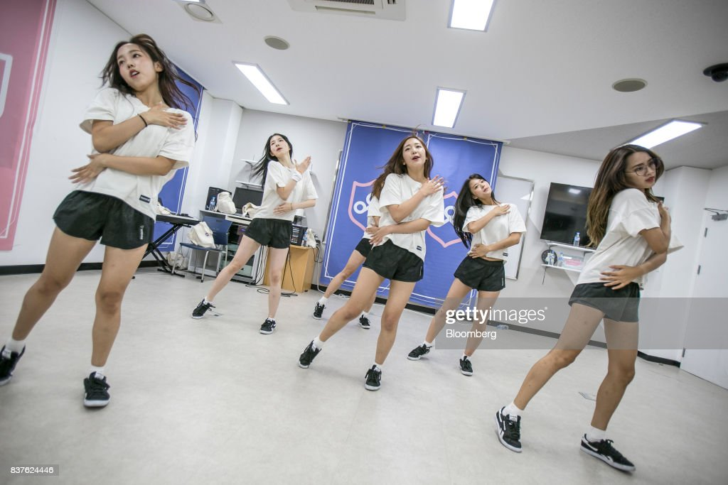 Contestants practice dance moves during the production of the 'Idol School' reality television show by CJ E&M Corp.at the Yangpyeong English School in Yangpyeong, South Korea, on Thursday, June 29, 2017. Endless repetition, tear-inducing critiques from coaches, smile practice, and psychological counselling are plot points in an 11-week reality TV show documenting the creation of a teeny-bopper singing group. Idol School, which began airing in July, is part of a corporate push to turn Korean pop music into a global phenomenon. Photographer: Jean Chung/Bloomber