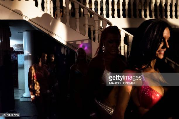 Contestants prepare themselves before going onstage for the Miss SA Xtreme fitness and bodybuilding show in Pretoria on June 17 2017 Dozens of local...
