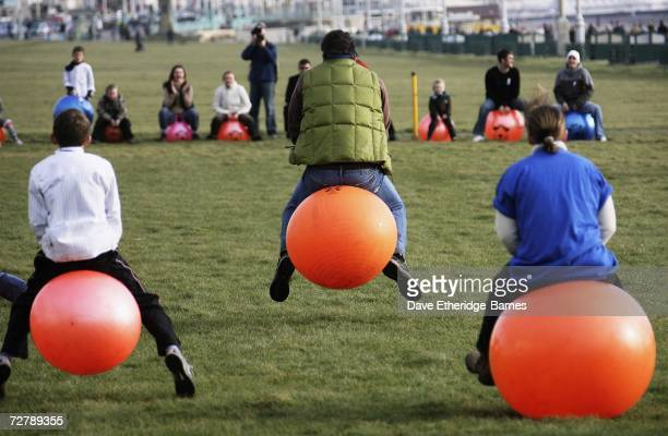 Contestants race on Space Hoppers during the 'Bounce Your Balls For Cancer' charity event on December 10 on Brighton Seafront in Brighton England The...