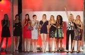 Contestants react after putting on a fashion show during a taping of the television show 'Germany's Next Topmodel' at the Fashion Show mall January...