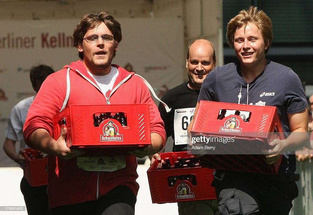 Contestants run with crates of beer during the Waiters' Derby (Kellner Derby in German) on August 4, 2013 in Berlin, Germany. At the annual event, brought back into existence in 2011 on the 125th anniversary of the Kurfuerstendamm (known locally as the Ku'damm), a main shopping thoroughfare, waiters, porters, cooks and bartenders run a 400-meter track while performing their regular occupational duties. The event was reinstated after a hiatus since the 1950s, when it was created to bring a sense of normal life back to Berlin after World War II under the Allies, a period in which gastronomical interest in the isolated Western part of the city suffered.