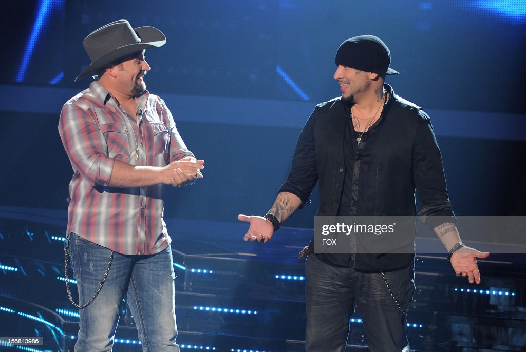 Contestants Tate Stevens and Vino Alan onstage at FOX's 'The X Factor' Season 2 Top 10 to 8 Live Elimination Show on November 22, 2012 in Hollywood, California.