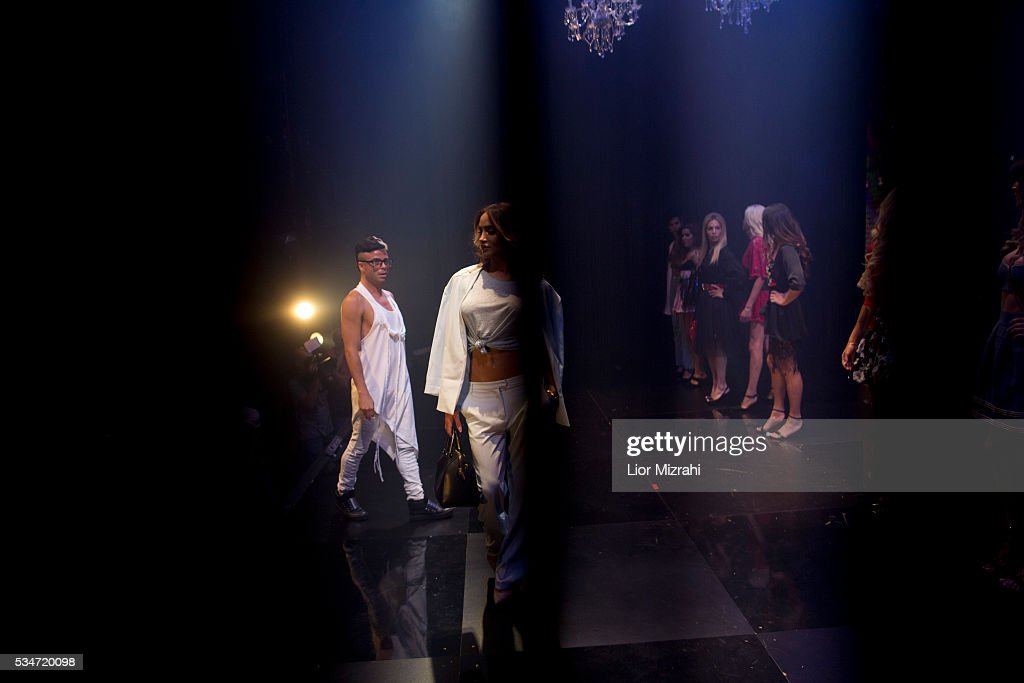 Contestants walk on stage during the first Miss Trans Israel beauty pageant on May 27, 2016 in Tel Aviv, Israel. Twelve Israeli transgender finalists took part in the event. The event marks the beginning of the 2016 Pride events.