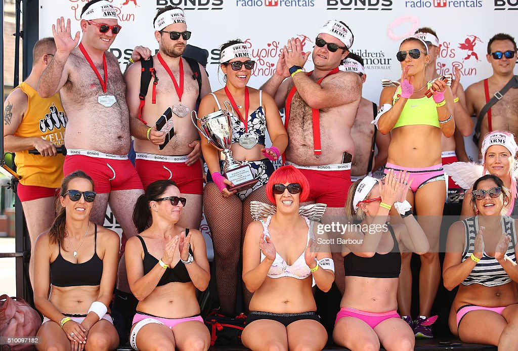 Contestants wearing their underwear collect their prizes on stage after taking part in Cupids Undie Run on February 14, 2016 in Melbourne, Australia. Cupid's Undie Run is an annual charity event. The fun run encourages people to run in their best pair of undies is held on Valentine's Day and raises money for the Children's Tumour Foundation of Australia. Cupid's Undie Run takes place in 36 cities worldwide and raised $3.5 million last year.