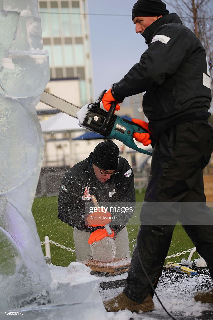 Contestants work on an ice sculpture at The London Ice Sculpting Festival at Canary Wharf on January 11, 2013 in London, England. Timed competitions between ice sculpting teams from Africa, France, Hungary, Netherlands, Portugal and the United Kingdom are taking place over the three day event.