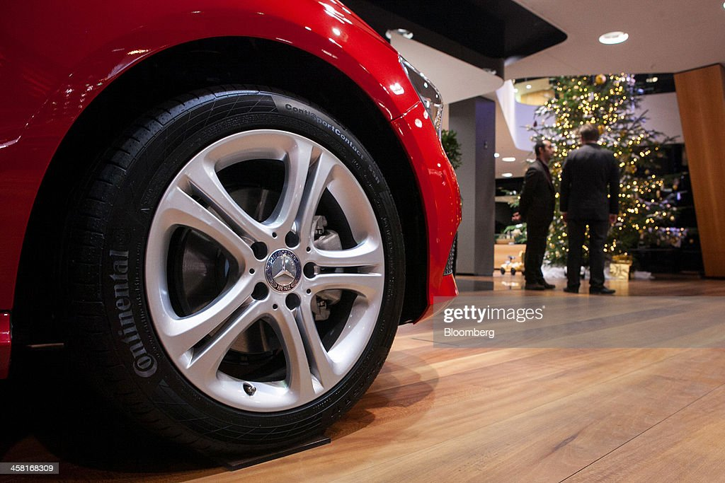 A Continental AG tire sits on a Mercedes-Benz A180, produced by Daimler AG, inside the Mercedes-Benz Gallery showroom in Berlin, Germany, on Thursday, Dec. 19, 2013. European new-car sales rose a third consecutive month in November, the longest period of gains in four years. Photographer: Krisztian Bocsi/Bloomberg via Getty Images