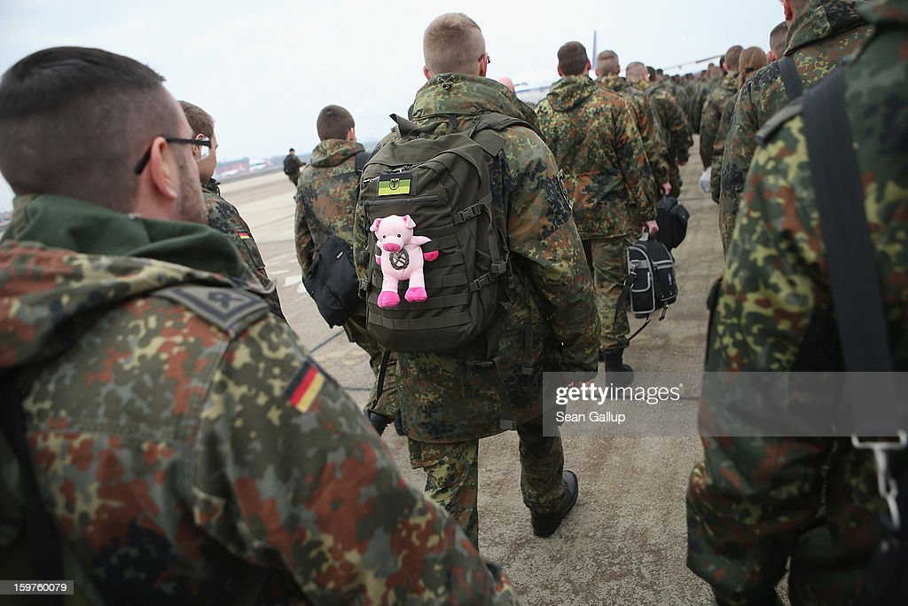 A contingent of approximately 240 soldiers of the German Bundeswehr, including one with a stuffed, pink pig attched to his rucksack, prepare to board a plane for Turkey on January 20, 2013 in Berlin, Germany. German is committing two units of Patriot anti-missile systems to help defend Turkey from possible attack from Syria.