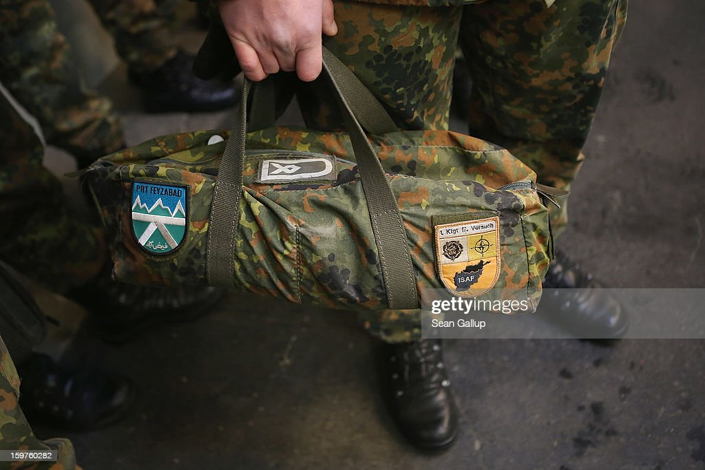 A contingent of approximately 240 soldiers of the German Bundeswehr, including one carrying a bag that shows previous service in Afghanistan, gather to board a plane for Turkey on January 20, 2013 in Berlin, Germany. German is committing two units of Patriot anti-missile systems to help defend Turkey from possible attack from Syria.